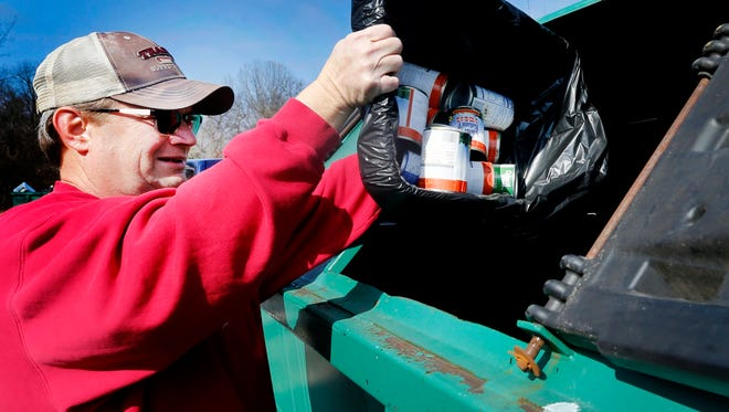 Ron Johnson recycles metal cans at the Rutherford County Recycling Center on Tuesday, Feb. 13, 2018.