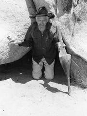 Harry Oliver kneeling with a peg leg.