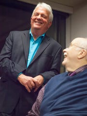 Free Press Executive Editor Mike Townsend, left, shares a laugh with Mike Donoghue at a retirement party celebrating both Townsend and Donoghue.
