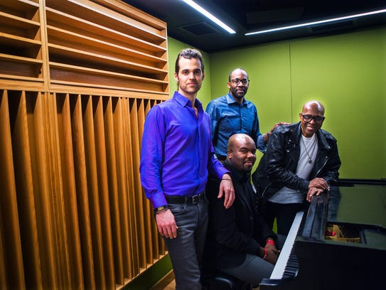 From left to right: Artist Matthew Michael, president Tony Alexander, executive Hamilton Hardin (at piano), and David Porter posed in 2017 for a portrait inside Made in Memphis Entertainment.