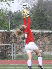 Katherine Ristola makes a save for Churchill's varsity girls soccer team this past spring.
