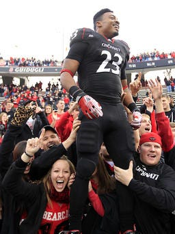Isaiah Pead, shown here after a University of Cincinnati win in 2011, remains in critical condition after an automobile accident.