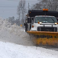A snow plow removes the remains of a light snowfall on Hwy 25 in Greenville early Thursday after a much smaller snow event than was predicted.