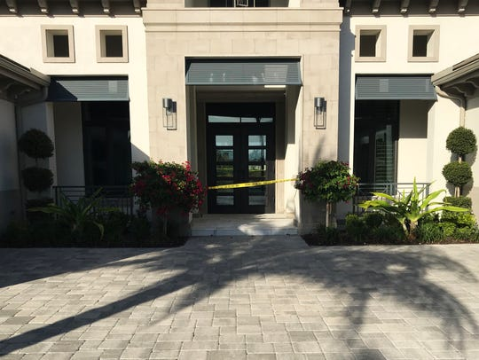 In this provided photo, caution tape blocks the entrance