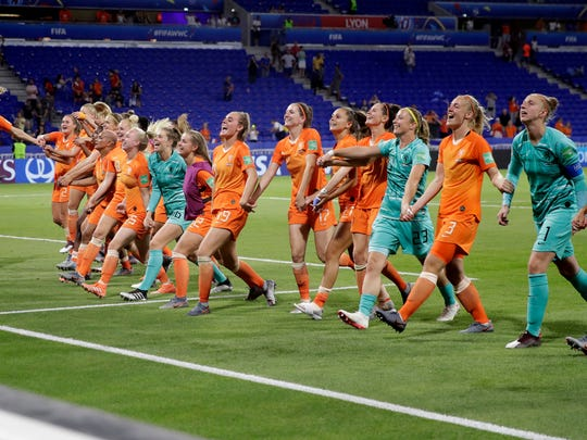 Netherlands players celebrate after defeating Sweden 1-0 to win their Women's World Cup semifinal soccer match at Stade de Lyon outside Lyon, France, Wednesday, July 3, 2019. (AP Photo/Alessandra Tarantino)