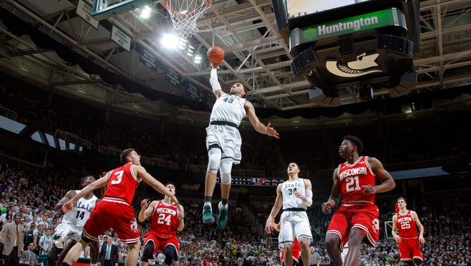 Michigan State's Denzel Valentine (45) goes up for a dunk against Wisconsin on Thursday, Feb. 18, 2016, in East Lansing.