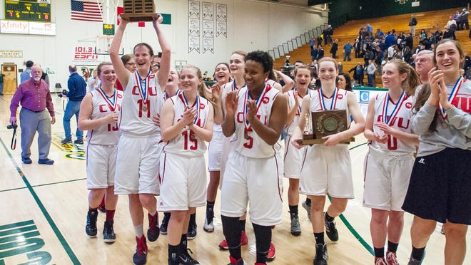 CVU celebrates its victory over Essex during the D-I high school girls basketball staet championship at Patrick Gymnasium in Tuesday.
