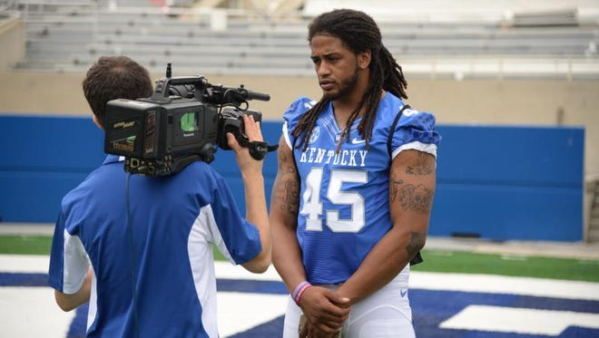 Senior linebaker Josh Forrest is interviewed during the University of Kentucky Football media day at Commonwealth Stadium in Lexington, Ky., on August 7, 2015.