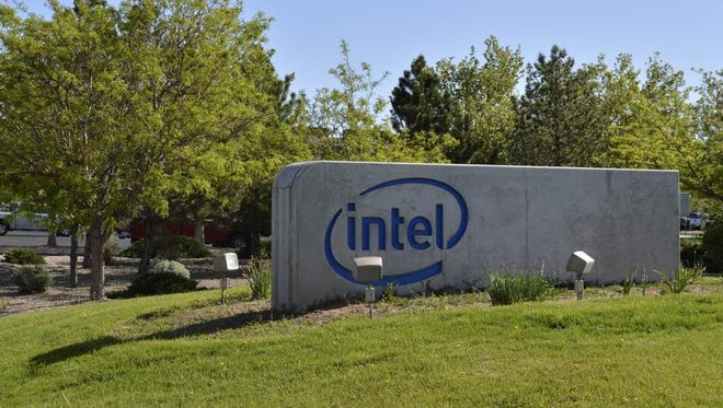 A sign outside of Intel's Rio Rancho plant is shown in this Monday, April 25, 2016 photo a week after Intel announced plans for massive job cuts across the company creating uncertainty in one of New Mexico's largest cities. The giant chipmaker is expected to unveil details this week that could determine the future of the company's plant north of Albuquerque.