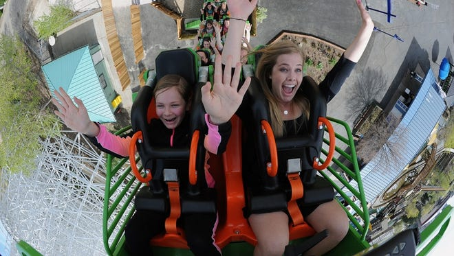 Riders enjoy Rolling Thunder, a circular roller coaster that stands seven stories high.