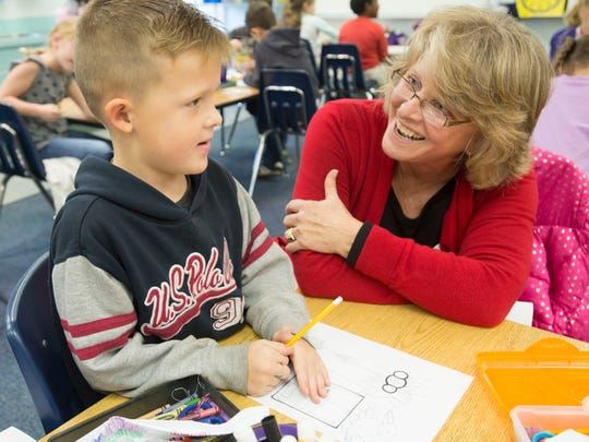 Artist Roberta Jonkers, right, talks Pea Ridge Elementary School student, Christian Welty, left, about careers in art during the school's career day Friday morning Jan. 15, 2016.