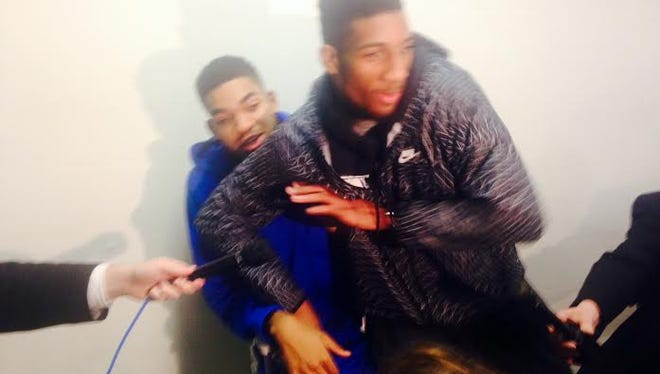 Marcus Lee and Karl-Anthony Towns cut up during interviews after UK's rout of Auburn. Lee sat on Towns.