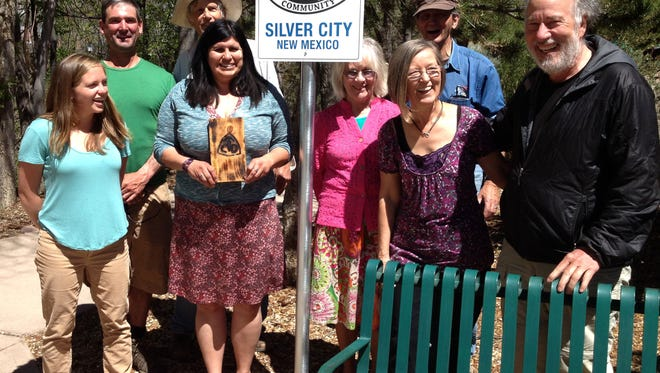 Christy Curd, Gateway Community Program coordinator, left, and Teresa Martinez, managing director of the Continental Divide Trial Coalition, third from left, meet with hikers and visitor center staff on Thursday in preparation for the CDT Trail Days celebration, which begins at 10 a.m. today.