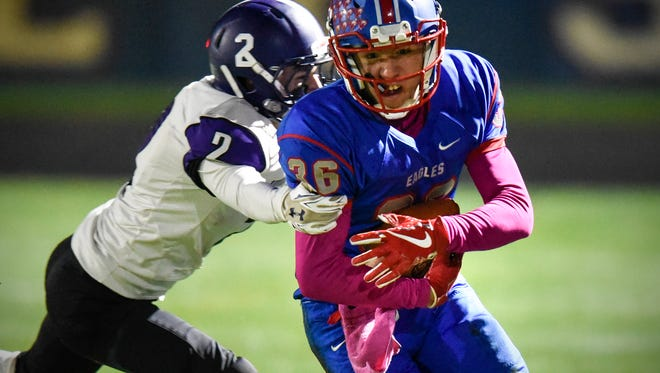 Gage Larsen of Little Falls tries to tackle Apollo's Jonh Sithamat during the Tuesday, Oct. 24 game at Apollo High School in St. Cloud.