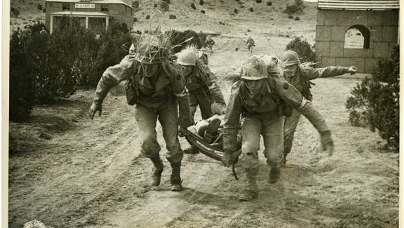Medics with the 89th Infantry Division train in a mock
