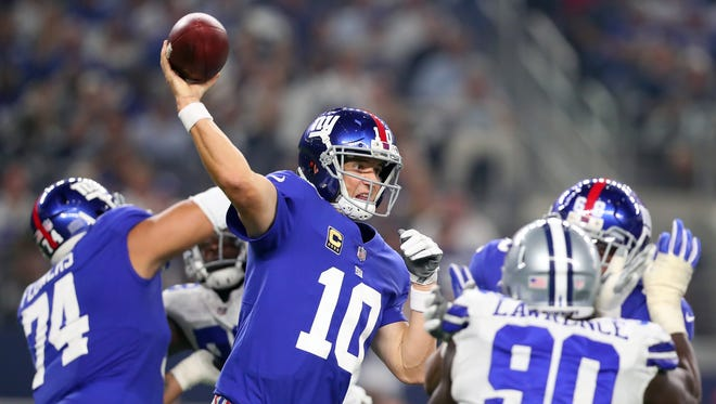 Giants quarterback Eli Manning passes against the Cowboys in the second quarter at AT&T Stadium on Sept. 10, 2017 in Arlington, Texas.