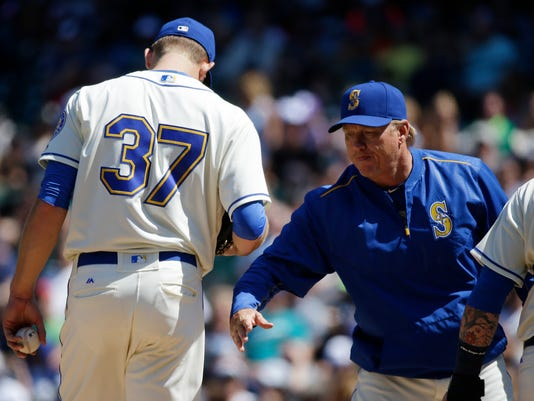 Seattle Mariners pitching coach Mel Stottlemyre, right, talks with starting pitcher Mike Montgomery (37) on the mound during the fifth inning of a baseball game against the Houston Astros, Sunday, July 17, 2016, in Seattle. (AP Photo/Ted S. Warren)