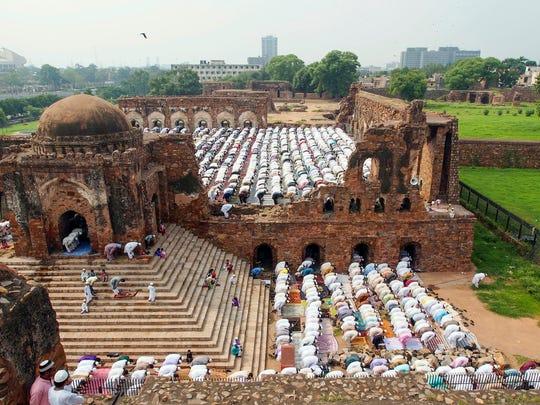 Muslims in Delhi at the Feroz Shah Kotla say the Eid Prayer, which commemorates festivals in the religion.