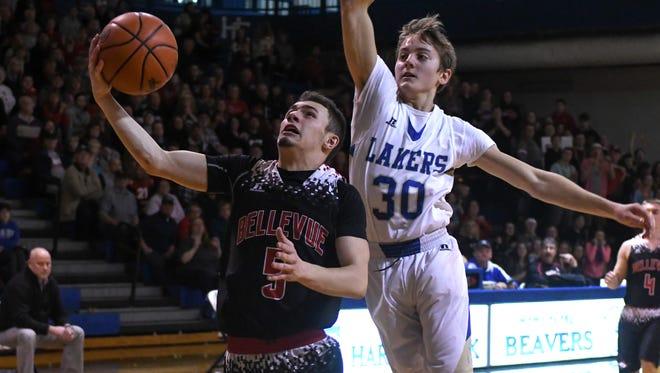 Bellevue's Wyatt Waterbury (5) drives the basket during game action Monday night.