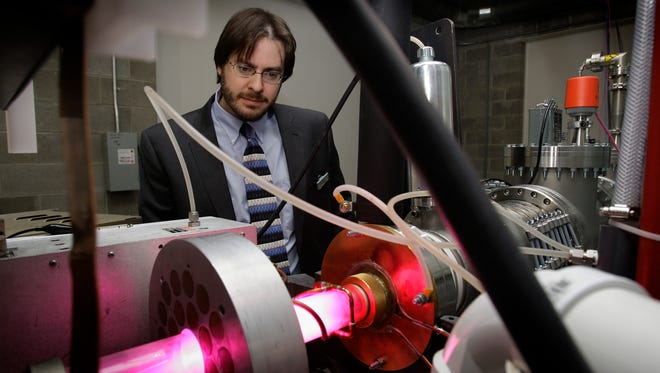 Greg Piefer, CEO of  Shine Medical Technologies, works on an early version of the equipment his company will use for medical isotope production on March 18, 2010.