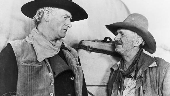 "John Wayne and Walter Brennan in ""Red River."""