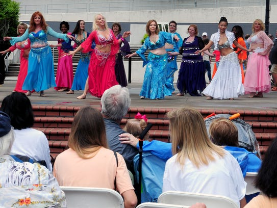 The Sandsation belly dancers perform on the Market Mall stage at the Knoxville Opera's 16th annual international Rossini Festival street fair April 22, 2017.