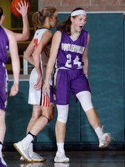 Fowlerville's Elie Smith, right, celebrates after scoring
