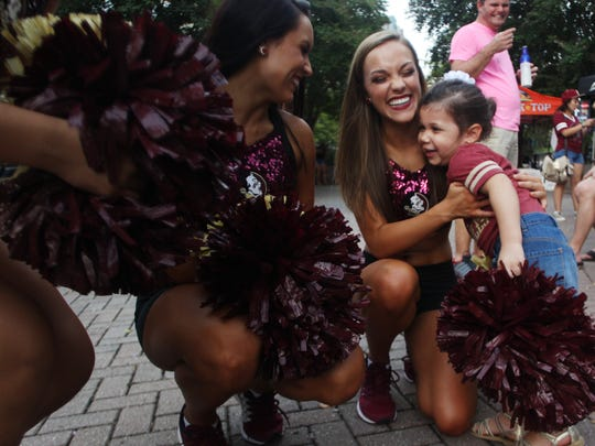 Thousands of people fill Tallahassee's Kleiman Plaza and Adams Street block Downtown Getdowns on Friday nights. Here, this girl hugs FSU Golden Girl Kierstin Casey.