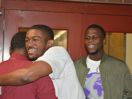 Rashard Johnson hugs a friend after being elected as