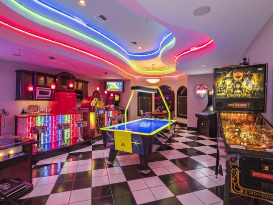 Game room! This waterfront 5-bedroom, 8-bath home on