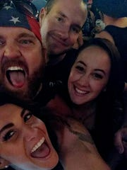Justin Zimmerman (top left), 31, of Dexter was with a group of friends Sunday during the onslaught at the Route 91 Harvest Festival in Las Vegas, where more than 50 people were killed and another 400 were wounded.
