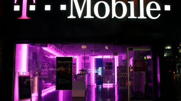 """FILE - An Oct. 19, 2012, file photo  is of a T-Mobile store  in New York.  The Federal Trad Commission  Tuesday July 1, 2014, is alleging that T-Mobile USA, Inc., made """"hundreds of millions"""" of dollars off its customers through bogus charges.  . (AP Photo/Mark Lennihan, file)"""