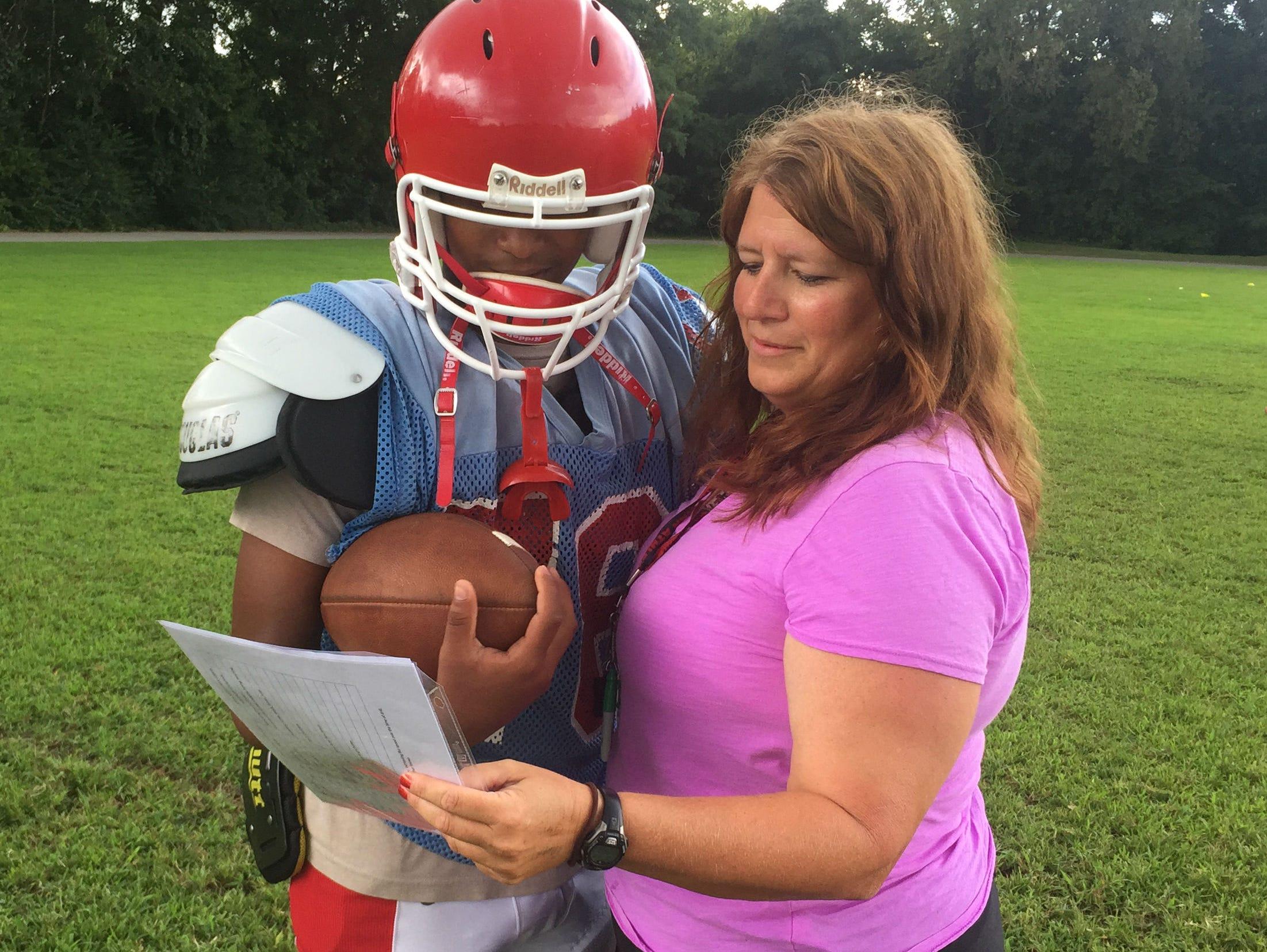 Glencliff quarterback Varon Solano with Colts assistant coach Lisa Limper.