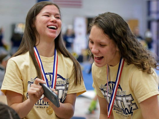 Kari Brekke, left and Callie Pohlmann share a laugh as Appleton North holds a state championship celebration for the girls basketball and cheer teams Sunday, March 12, 2017, at Appleton North High School in Appleton, Wisconsin.