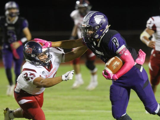 Shadow Hills High School's Kaleb Welmas evades La Quinta High School's Jesus Corona  during their game in Indio on October 13, 2017.
