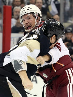 Arizona Coyotes right wing Shane Doan (top) and Pittsburgh Penguins right wing Steve Downie (23) fight during the second period at the CONSOL Energy Center in Pittsburgh on March 28, 2015. The fight was in response to Doan's relier hit on Kris Letang.