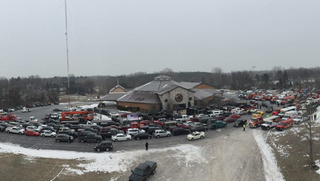 Cars and trucks line up for the funeral procession for Jason Schultz at Ross Bible Church.