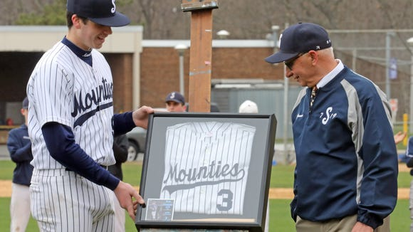 Suffern player Nick Casablanca presents baseball jersey