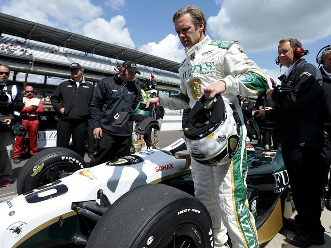 Ed Carpenter exists his car after a qualification speed of 230.114, which gave him the fastest speed to that point, for the Indy 500 at the Indianapolis Motor Speedway, Saturday, May 17, 2014, in Indianapolis.