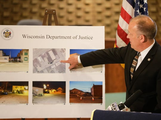 Attorney General Brad Schimel points to an aerial view of Eagle Nation Cycles during a May 6 press conference at Neenah City Hall.