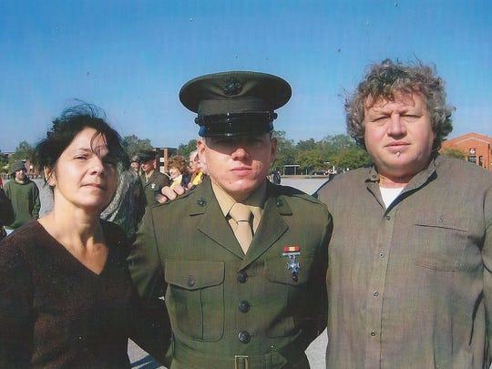 Marine veteran Jacob Faulkner, center, pictured in uniform with this parents.