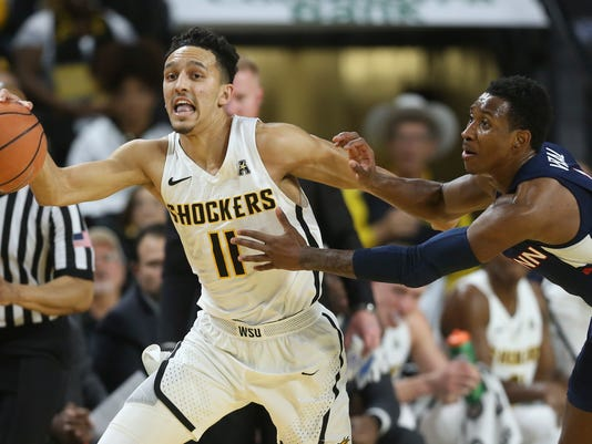 Wichita State guard Landry Shamet (11) steals the ball and is fouled by Connecticut guard Christian Vital during the first half of an NCAA college basketball game Saturday, Feb. 10, 2018, in Wichita, Kan. (Travis Heying/The Wichita Eagle via AP)