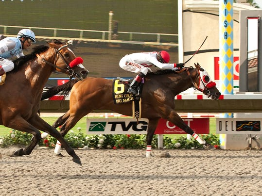In a photo provided by Benoit Photo, Big Macher and jockey Tyler Baze, right, hold off Goldencents, left, with Rafael Bejarano, to win the Grade I, $300,000 Bing Crosby Stakes horse race, Sunday, July 27, 2014, at Del Mar Thoroughbred Club in Del Mar, Calif. (AP Photo/Benoit Photo)