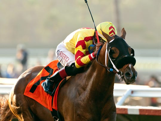 In a photo provided by Benoit Photo, Red Outlaw and jockey Edwin Maldonado win the $200,000 Real Good Deal Stakes horse race Friday, Aug. 1, 2014 at Del Mar Thoroughbred Club in Del Mar, Calif. (AP Photo/Benoit Photo)