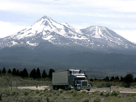 In this June 19, 2008, file photo a truck drives past Mount Shasta near Weed, Calif.
