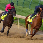 Two of trainer Bob Baffert's possible Derby candidates, Bayen, left, and Chitu worked Monday at Churchill Downs.