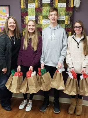 Green Township residents Rhonda Gottmann and her children, Claire, Nathan and Grace, deliver care bags that they created for cancer patients at OHC Anderson receiving chemotherapy during the holiday week.