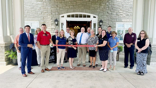 Surrounded by members of the Ashland Area Chamber of Commerce and the community, the staff at the Inn at Ashland Woods cuts the ribbon on its new assisted living center July 15. The newly renovated facility, located in the original Hospice of North Central Ohio building at 1050 Dauch Drive, is the only assisted living community to have a unit specifically created for memory care patients.