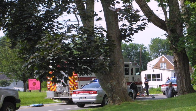Granville Township and West Licking firefighters and medics are pictured at the scene of a two-car crash on Ohio 16 at Sunset Drive just southwest of Granville