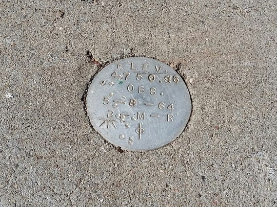 "A survey marker dated ""5-8-64"" is seen at the Tortugas South Observatory on top of Tortugas ""A"" Mountain. The building is slated for demolition, starting Wednesday."